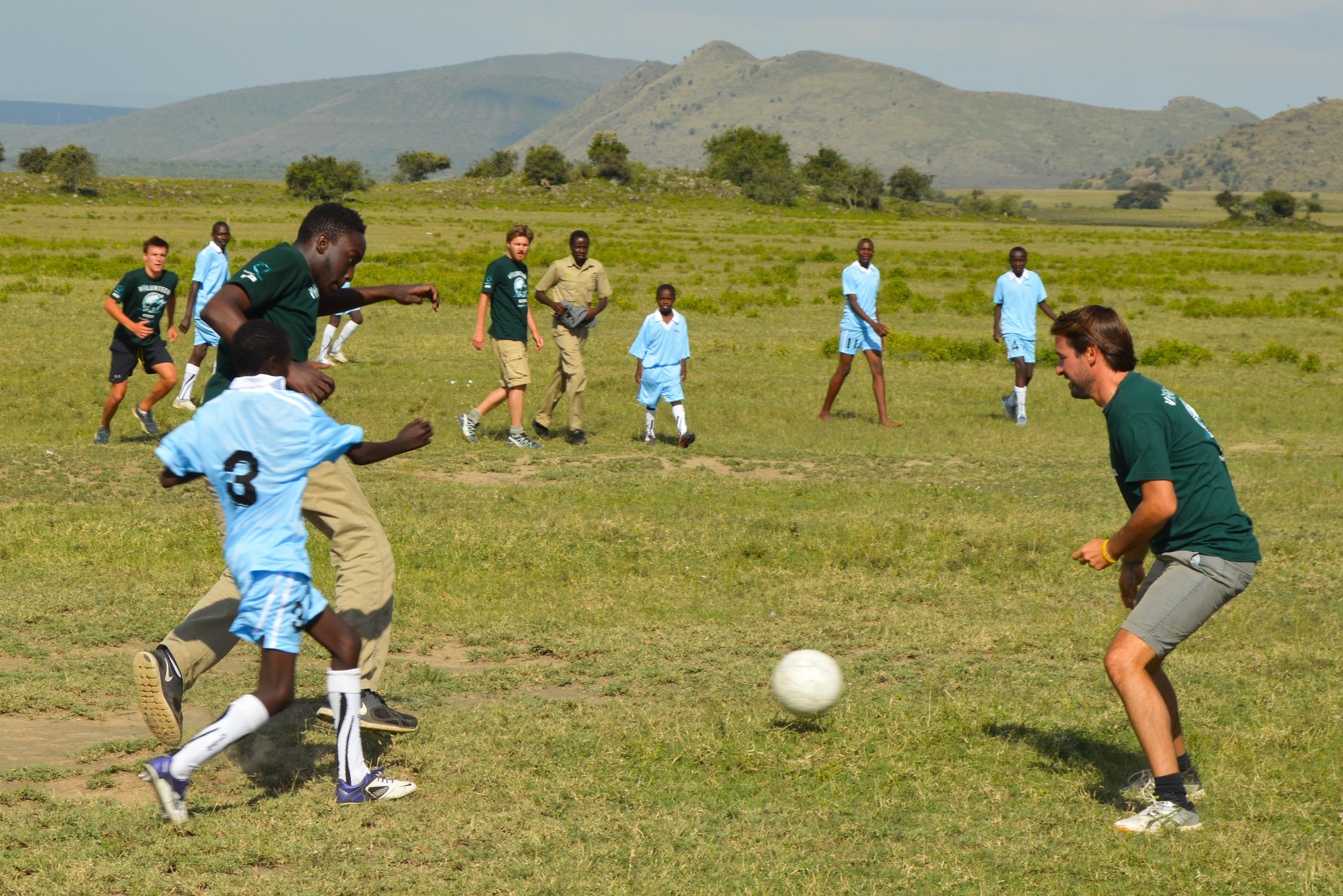 Volunteers and local students playing football on one of our Sports volunteering opportunities.